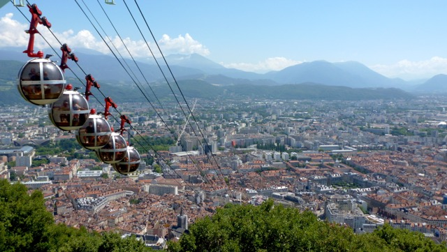 "Grenoble, France and its Telepherique ""Les Bulles"" as seen from the city's mountaintop Bastille"